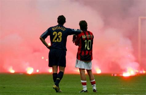 Inter Milan's Materazzi and Rui Costa of AC Milan wait on