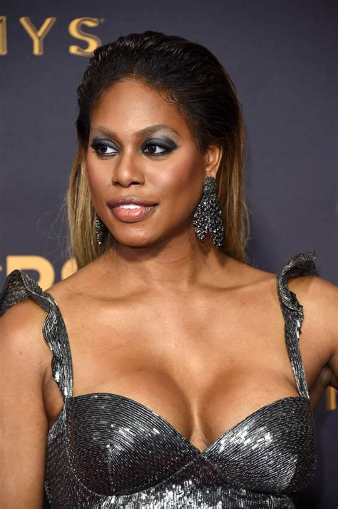Laverne Cox in shimmering silver with others at 2017 Emmy